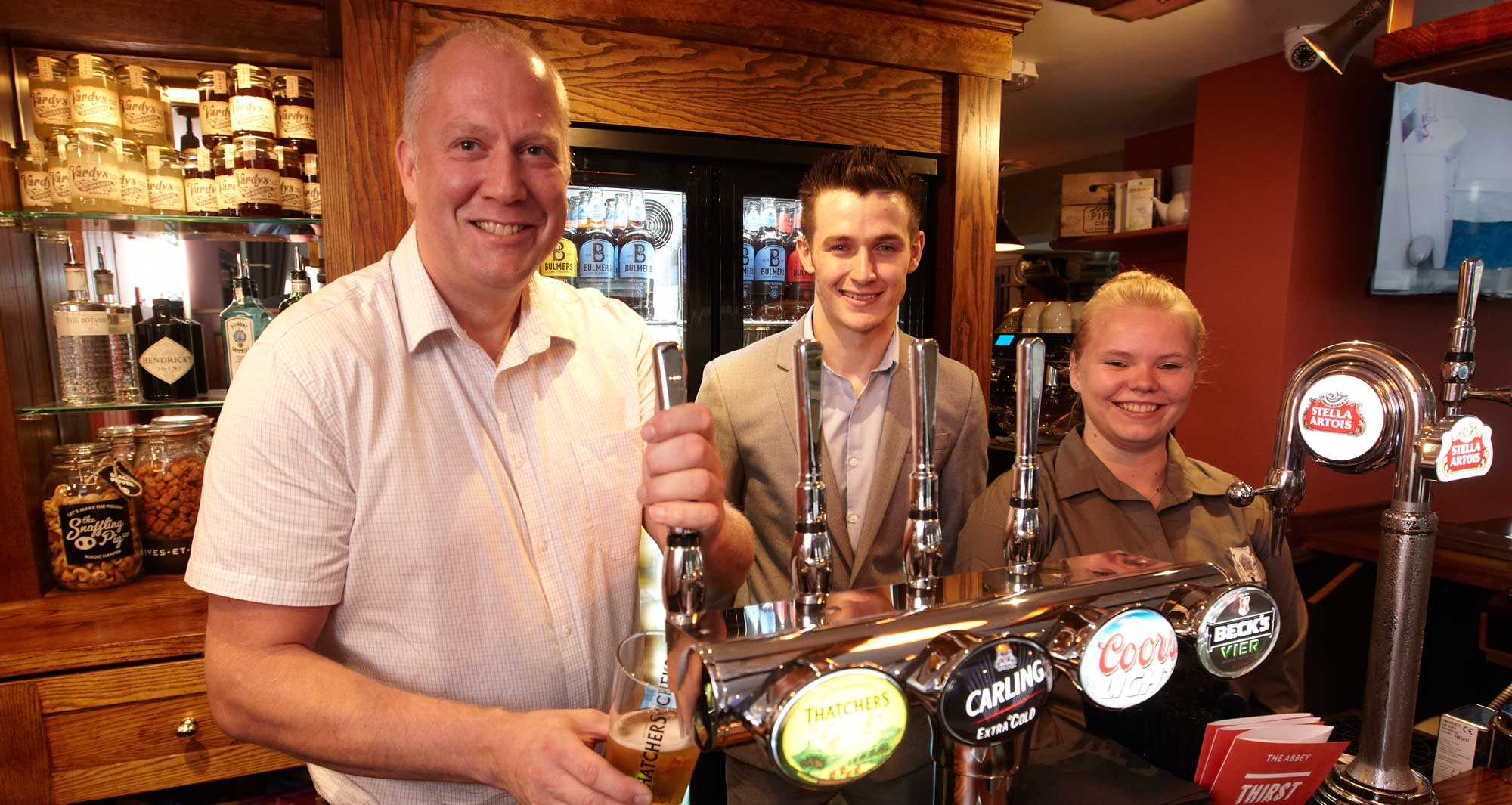 Friendly Staff serving real ale